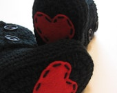 Crochet baby and toddler size booties. 0 to 3 months,6 to 12 month, 12 month, 18 month, 24 month.  Black booties with hearts.