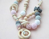Pink and grey set of 2. Teething ring toy and nursing necklace. Light lpink, white, grey rattle for baby and mom.