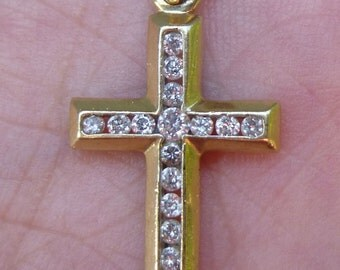 Over half a carat 52 points in this beautiful yellow gold cross pendent