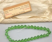 Strand of 30 vintage German machine cut crystal beads - 8 x 8.3 mm faceted cones - emerald