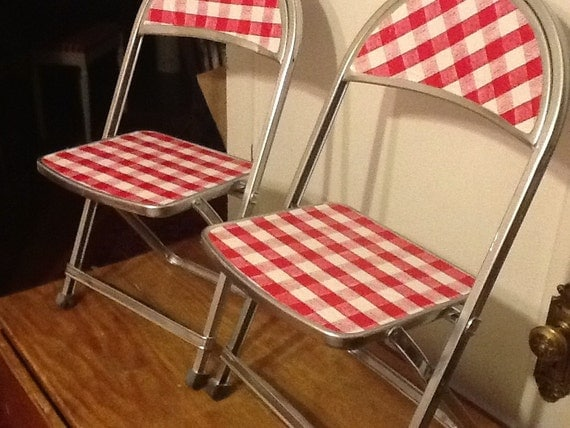 pair of child size metal folding chairs by thepuppydogtails