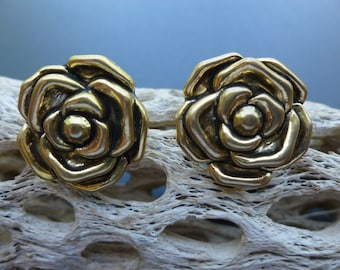 Large Gold flower clip earrings.