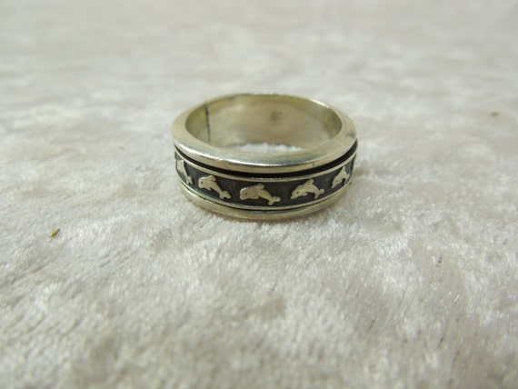 sterling silver spinner worry band ring modern design dolphins