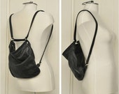 Private listing for coocoobananas: vintage convertible leather purse - made in Canada