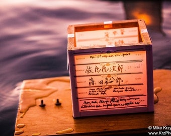 Floating Lantern w/ Japanese Writing on the Ocean in Honolulu, Hawaii