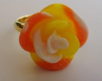 Adjustable Sparkling Flower Ring.In a Sweet Orange