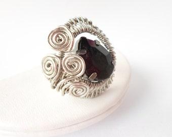 Woven twirl ring