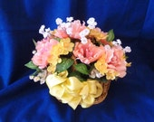 Floral Arrangement,  Silk Floral Arrangement in Pink,Yellow and White in a Tan Woven Wicker Basket.