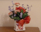 Flower Arrangement, Floral Arrangement, with a Fluffy Red Bow on Red, Pink and Lilac Flowers in a Ceramic Pot