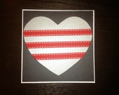 Grey/Silver heart with three red and white ribbon stripes on black background - blank anniversary card