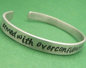 Armed With Overconfidence And A Small Screwdriver - A Hand Stamped Aluminum Bracelet