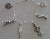 Sterling Silver Charm Bracelet with Man, Woman, Fish, Heart. Sun, Horn