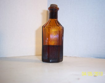 1920's 3 5/8 inch tall 6 sided Amber Poison Bottle