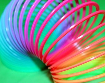 Slinky photography colorful toy photo fine art print retro toy pink green blue purple childs room decor classroom teacher gift