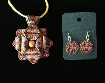 Beautiful Sculptural pendant with matching earrings