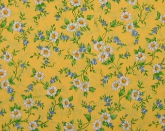 Daisies and blue flowers on yellow print