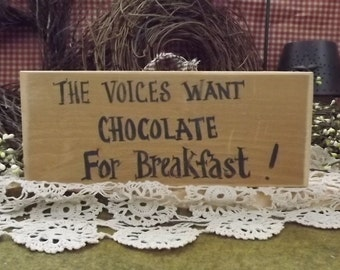 "Funny wooden sign."" The voices want chocolate for breakfast"" Hand painted, made in the u.s.a."