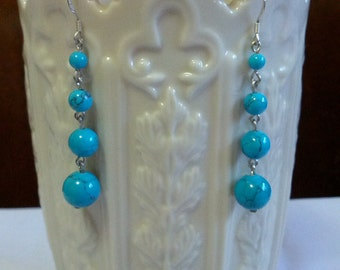 Beautiful dangle faux turquoise earrings set with gold tone metal