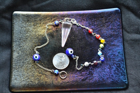Evil Eye Pendulum set with 2 chains.  LOTS of eyes