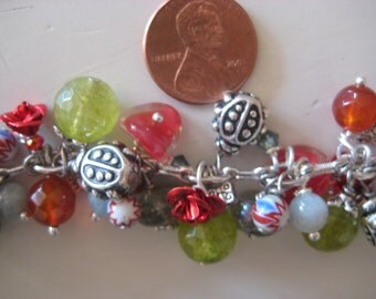 Bracelet with lucky lady bug charms  and faceted peridot