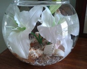 Large vase bowl centerpiece with pure white lillies, shells and glowing base