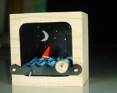 Kinetic Wooden Sailboat Sculpture with Night Sky