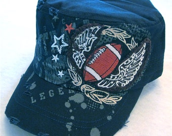 Football Cap In Navy Blue with rhinestones decorating the wings on the sides.