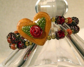 "Heart Bracelet, 7.5"" Double Strand with Polymer Heart Centerpiece and Toggle Clasp"