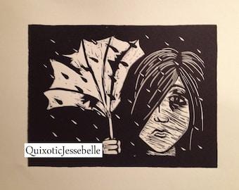 Linocut of a girl in the rain with a broken umbrella