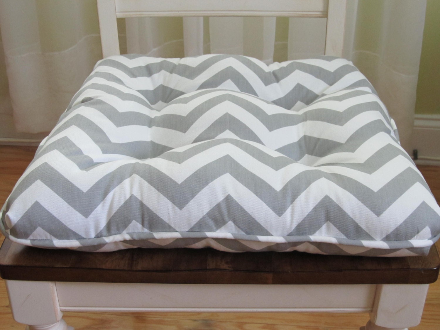 tufted custom chair cushion with piping trim in gray by homestyled