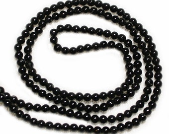 Black tourmaline smooth rounds, natural.  Approx. 2.25mm - 2.5mm.  Select a strand length.