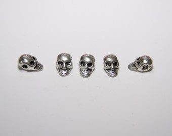 15 Pcs. Metal bead / Spacer bead / skull / 6x10mm color: silver MP084