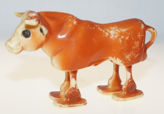 Small Toy Cows : Hong kong plastic ramp walker cow toy
