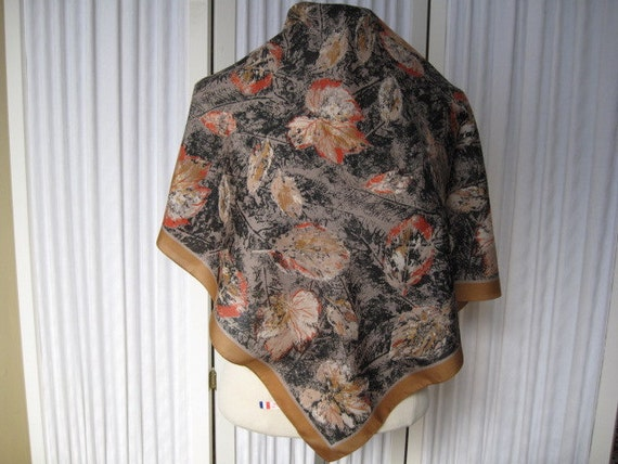 Lovely Monique Martin Designer Italian Polyester scarf in Tan, Grey, Black and Orange
