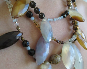 OOAK Triple-strand necklace of brown and light blue beads with eliptical agate stone features