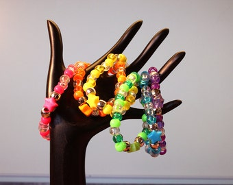 Set of 6 Rainbow Colored Seethrough Singles Kandi