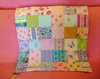 Mini vintage fabric patchwork quilt. Pink, yellow, lilac, blue. Original and unique
