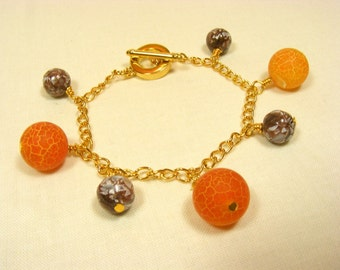 Chocolate and Orange Charm Bracelet