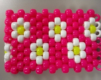 EDC white opaque daisies with a pink neon background and neon yellow buds