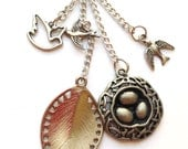 Long Charm Necklace with Bird's Nest, Two Bird Charms and a Large Leaf Charm