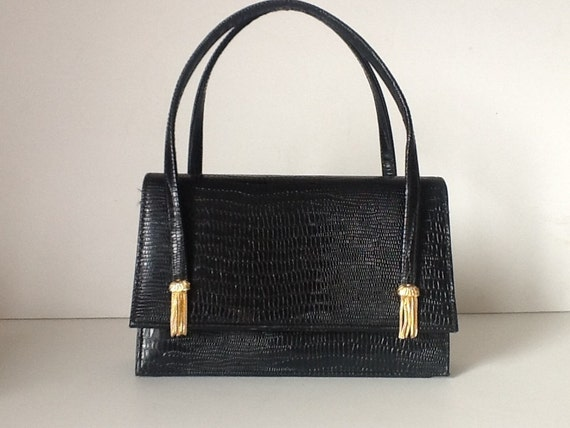 75fc3eeddf53 Saks Fifth Avenue Vintage Handbags | Stanford Center for Opportunity ...
