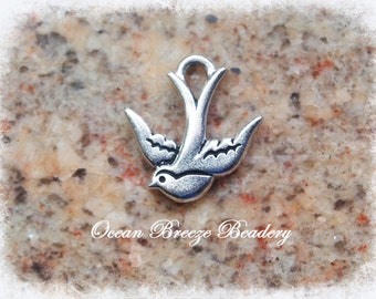 2 Diving Swallow Charms . Silver Plated Pewter