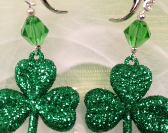 St Patricks Glittered Shamrock earrings w/ crystal bead. Overall length 2 in. lever back wires