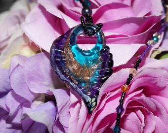 Pegasus Necklace. Fanciful focal suspended on a beaded necklace with multicolored crystals and pearls.