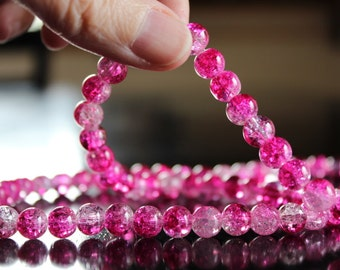 100 approx. hot pink and clear 8 mm crackle glass beads, 1mm hole, round