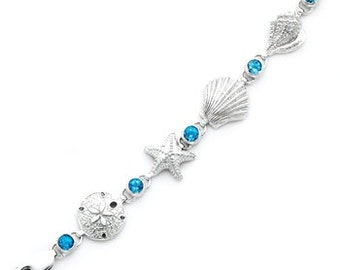 Sterling Silver Seashell, Sand dollar & Starfish combination bracelet with genuine London Swiss Blue Topaz stones.