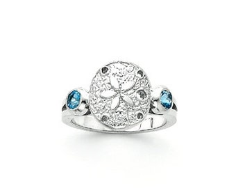 Sterling Silver Sand dollar ring w/ Blue Topaz side stones