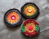 Three antique beaded and embroidered golden kuchi disks