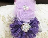 Two tones of purple flowers centered with beautiful gems on purple headband