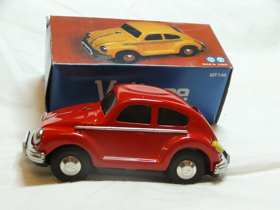 Collectors Tin Toy - Frictioned Powered Red VW Beetle